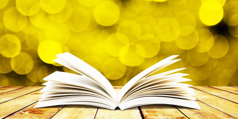 Header Image - open book with yellow background