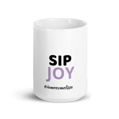 White ceramic mug saying, SIP JOY, by iamrevmelissa.